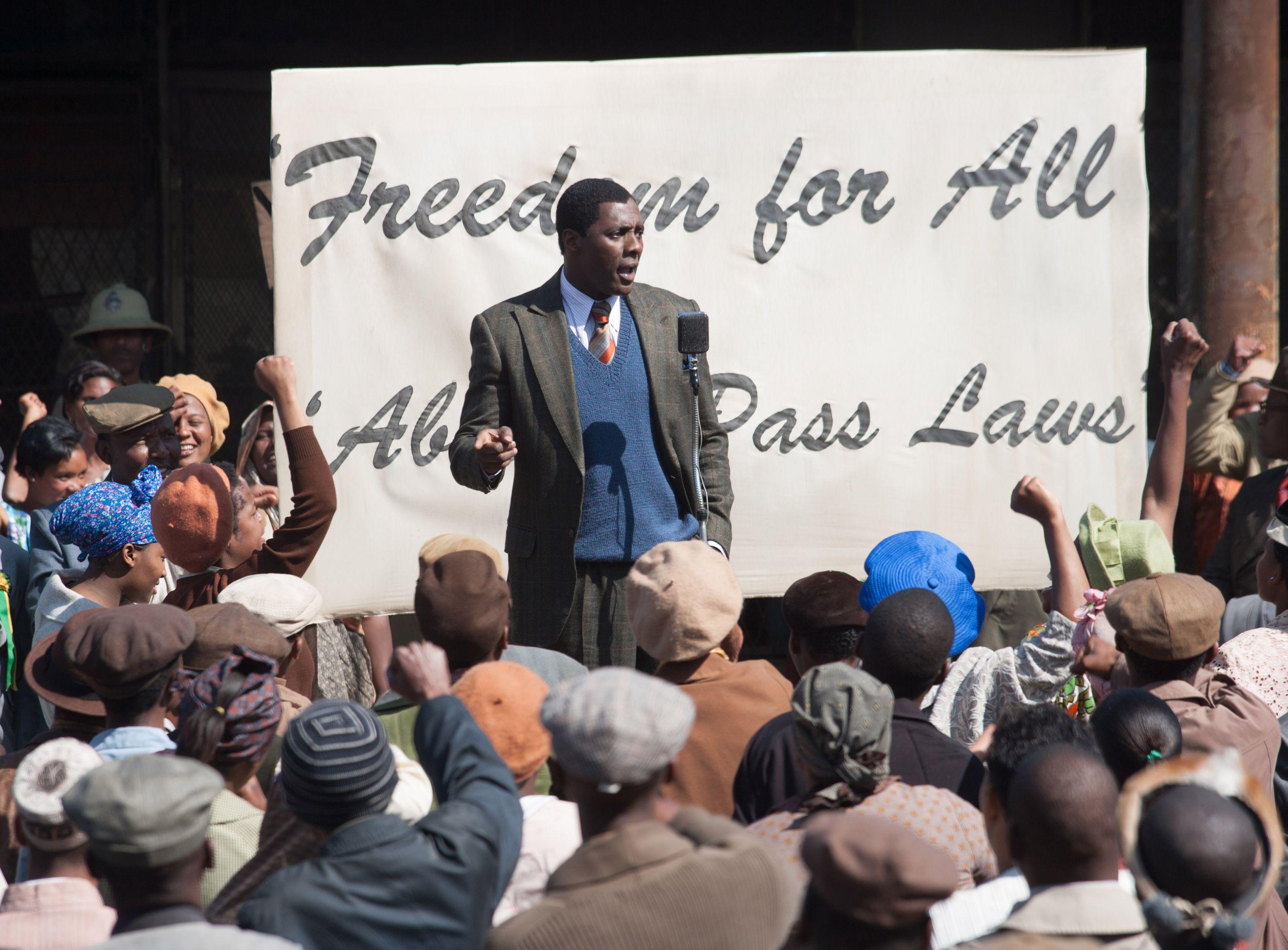 Idris Elba gives a speech as Mandela