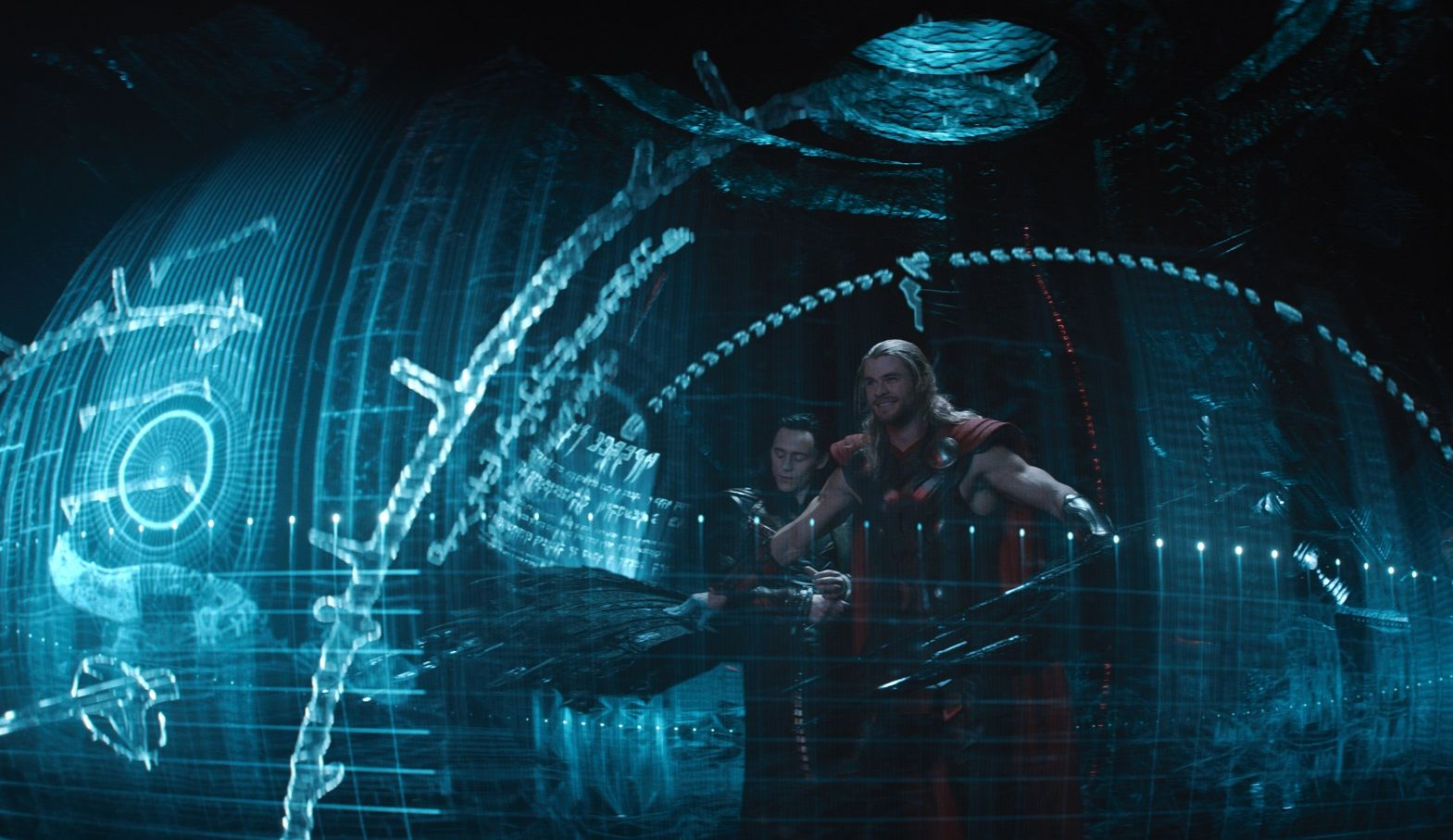 Thor and Loki fly around in futuristic blue ship thingy
