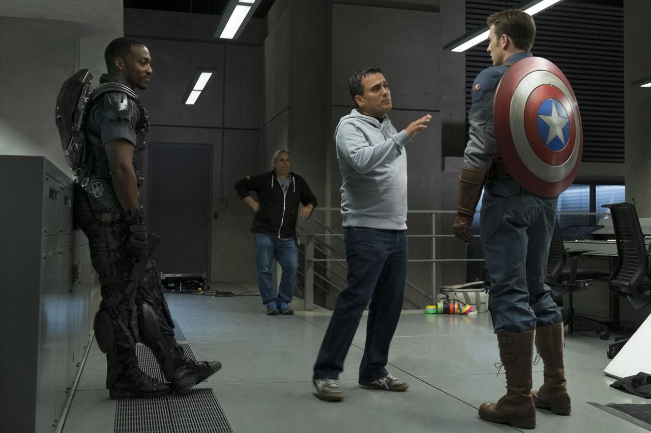 Chris Evans and director, Anthony Russo, talking it over.