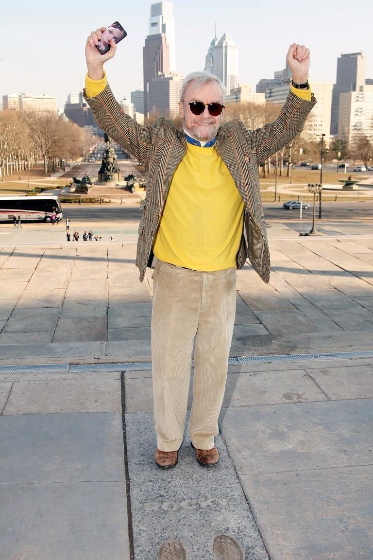 Rocky director John G. Avildsen recreates famous victory pos