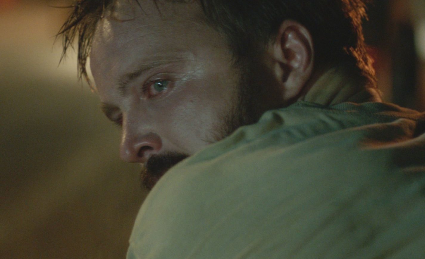Aaron Paul looking over his shoulder in Hellion