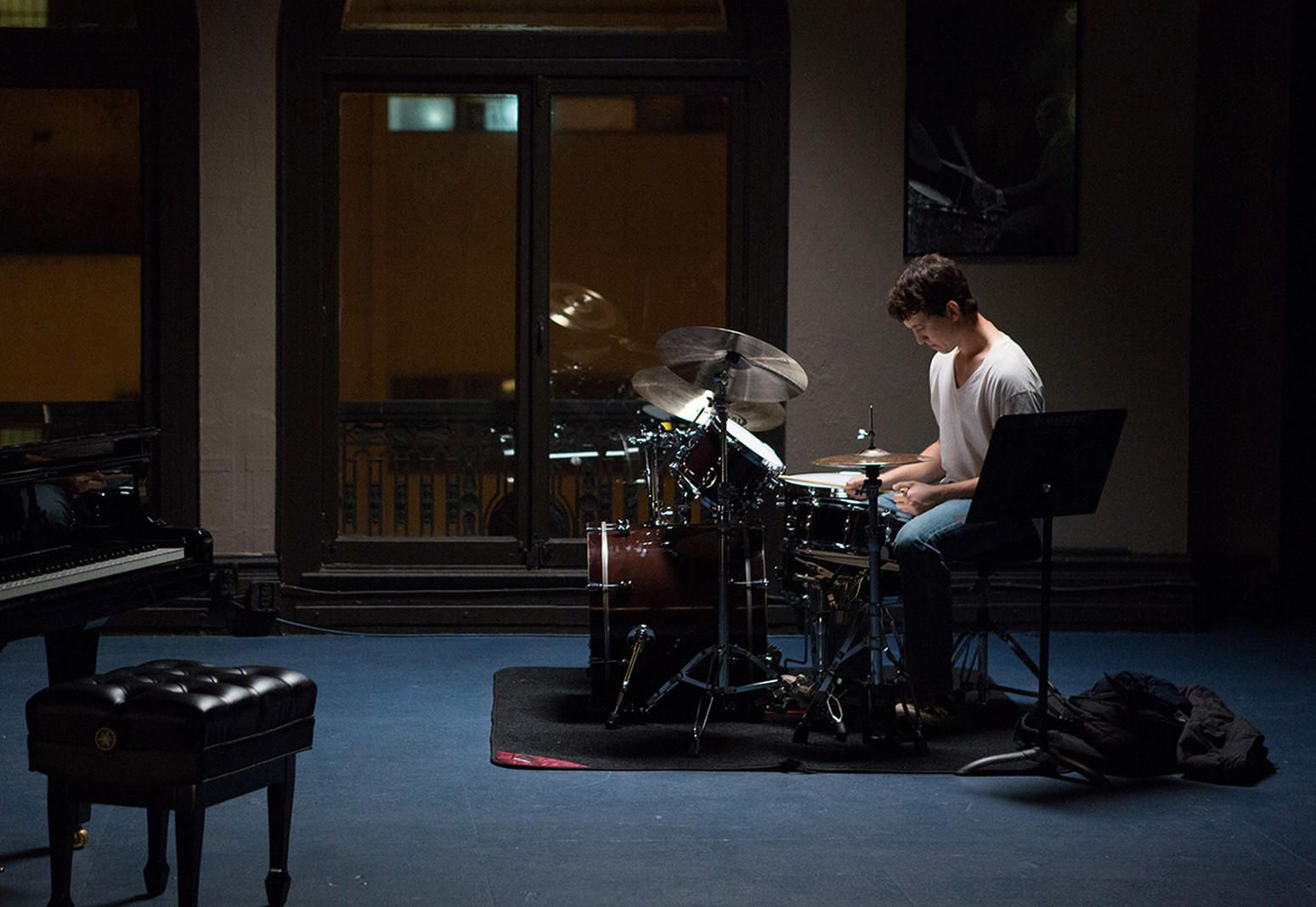 Miles Teller as Andrew Neyman practicing his drums alone