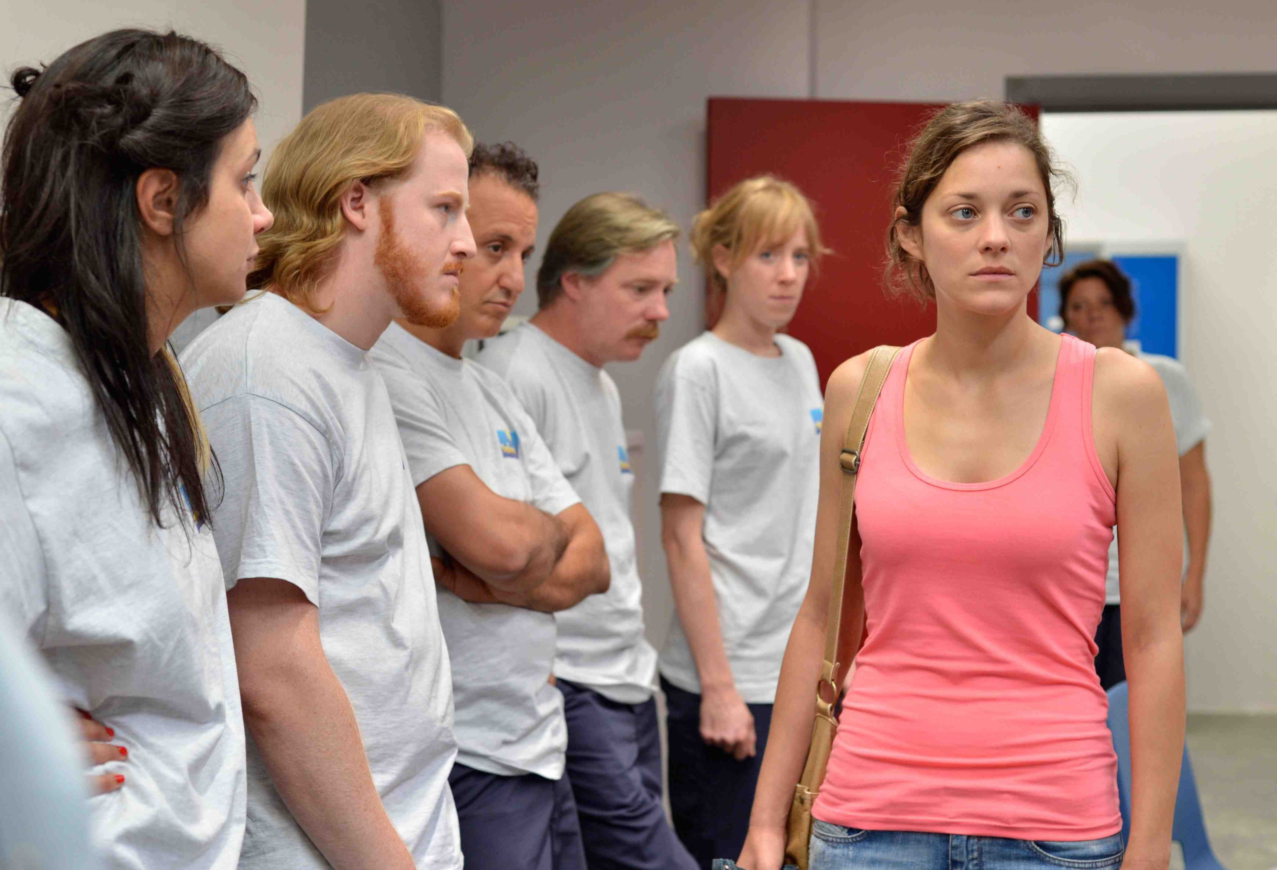 Marion Cotillard as Sandra being judged by her co-workers