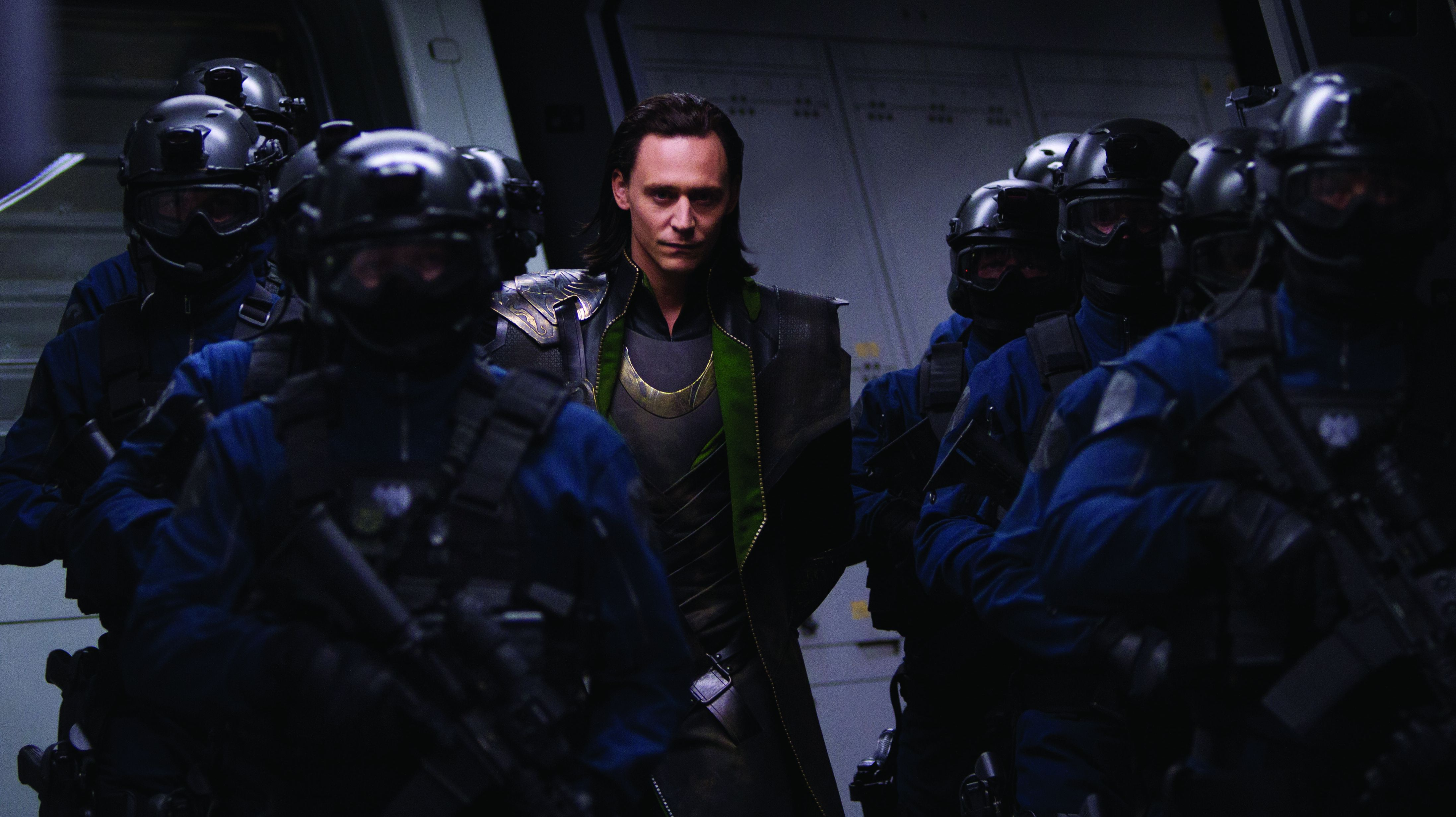 Tom Hiddleston closely guarded as Loki in The Avengers