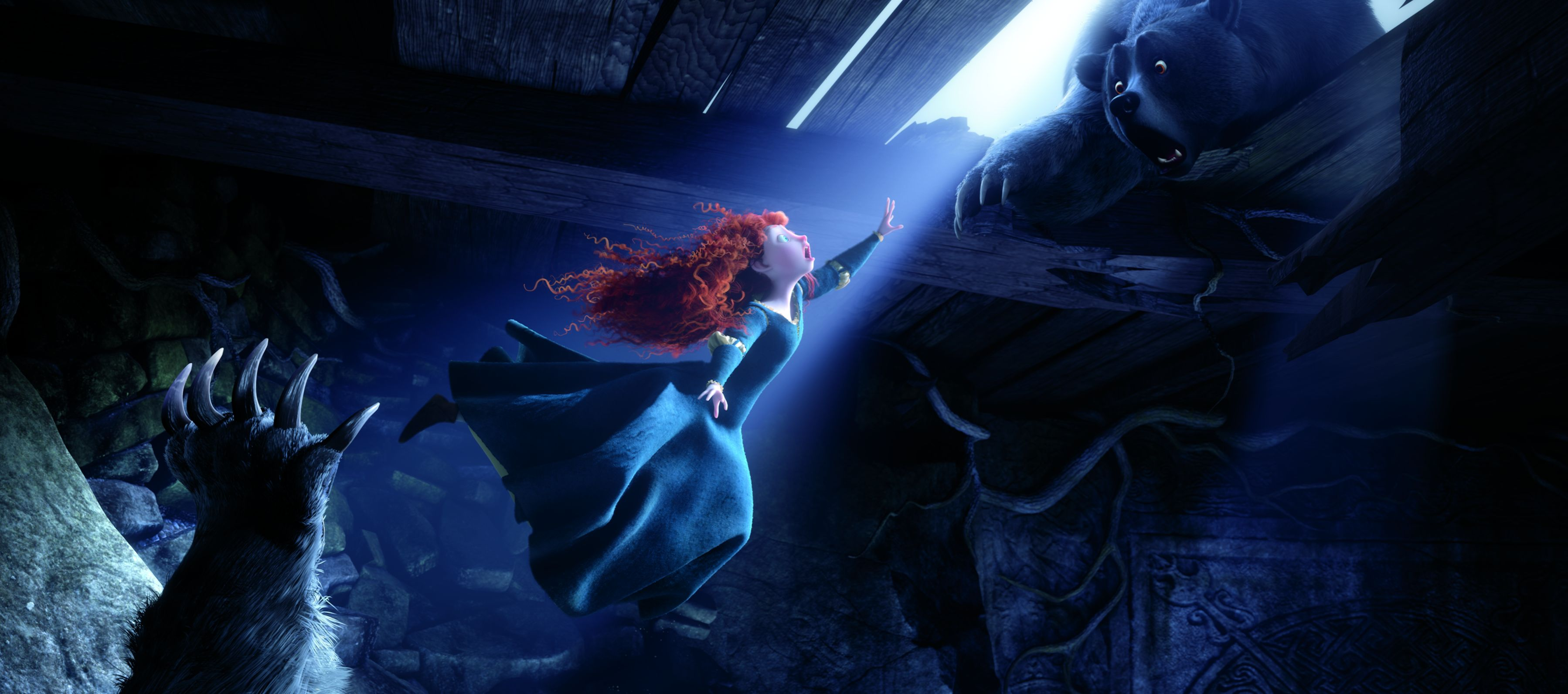 Merida falls as the bear tries to grab her hand in Brave