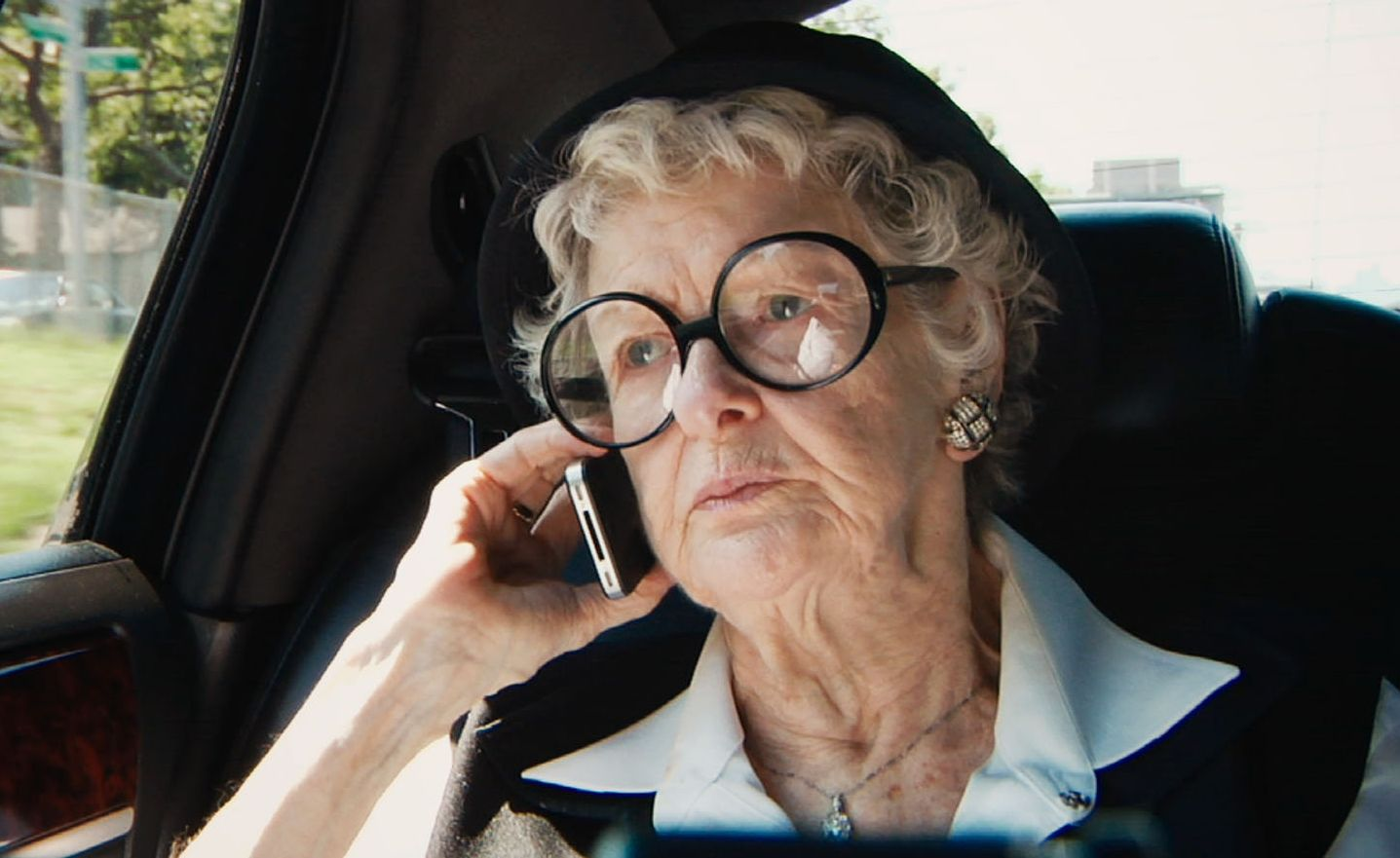 Elaine Stritch on the phone with her big glasses