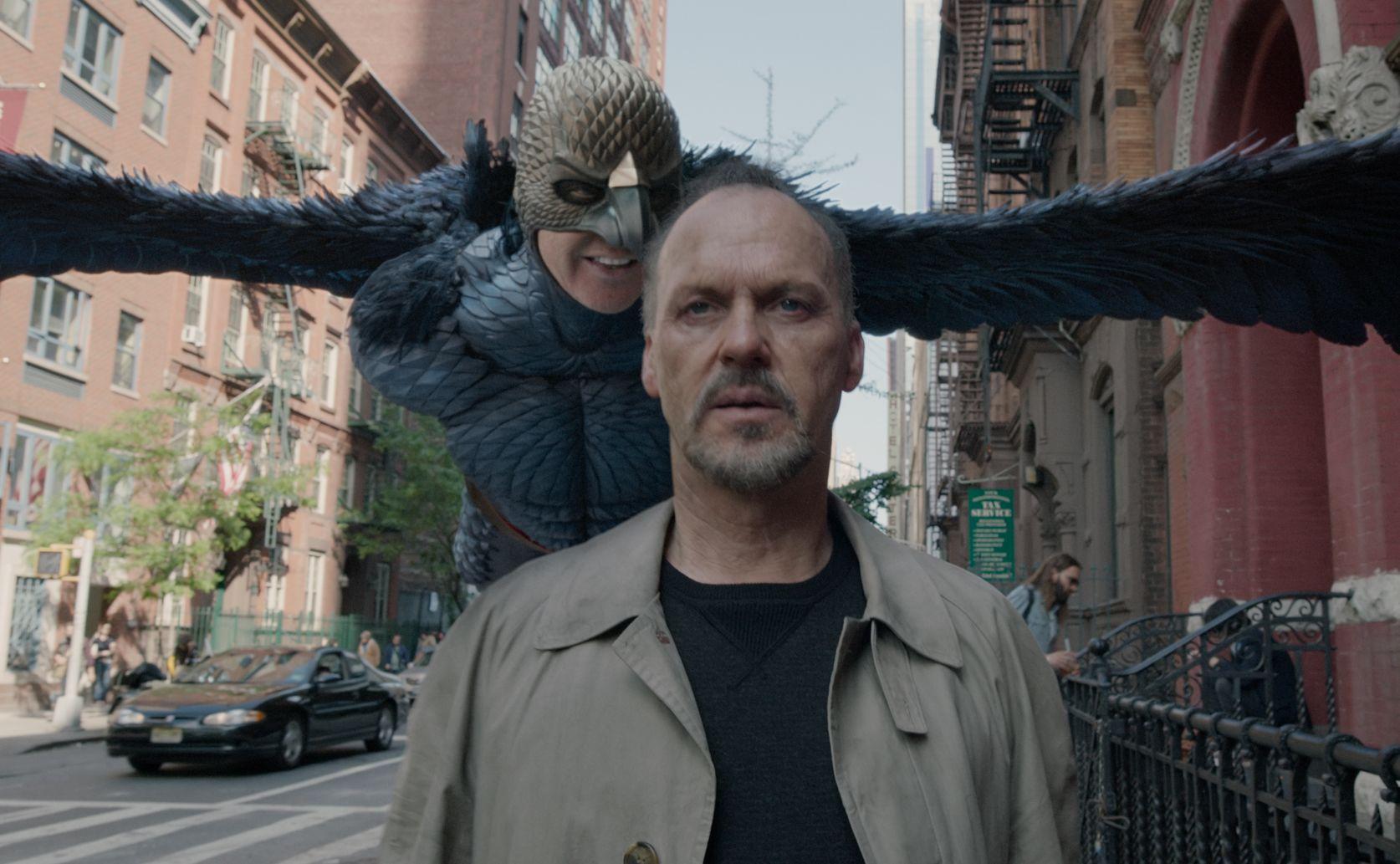 Bird flying behind Michael Keaton in Birdman