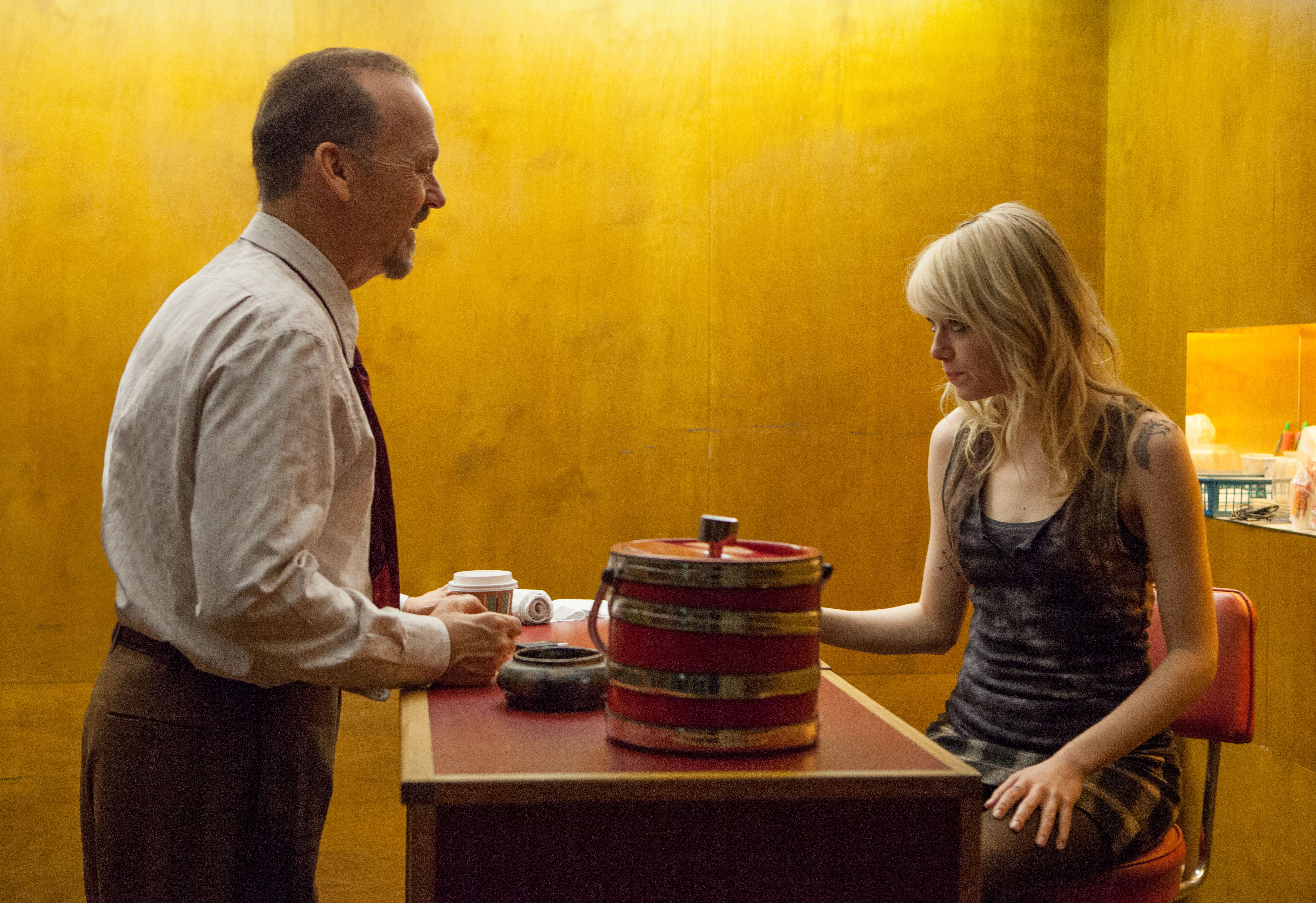 Michael Keaton and Emma Stone in stark yellow on the set of