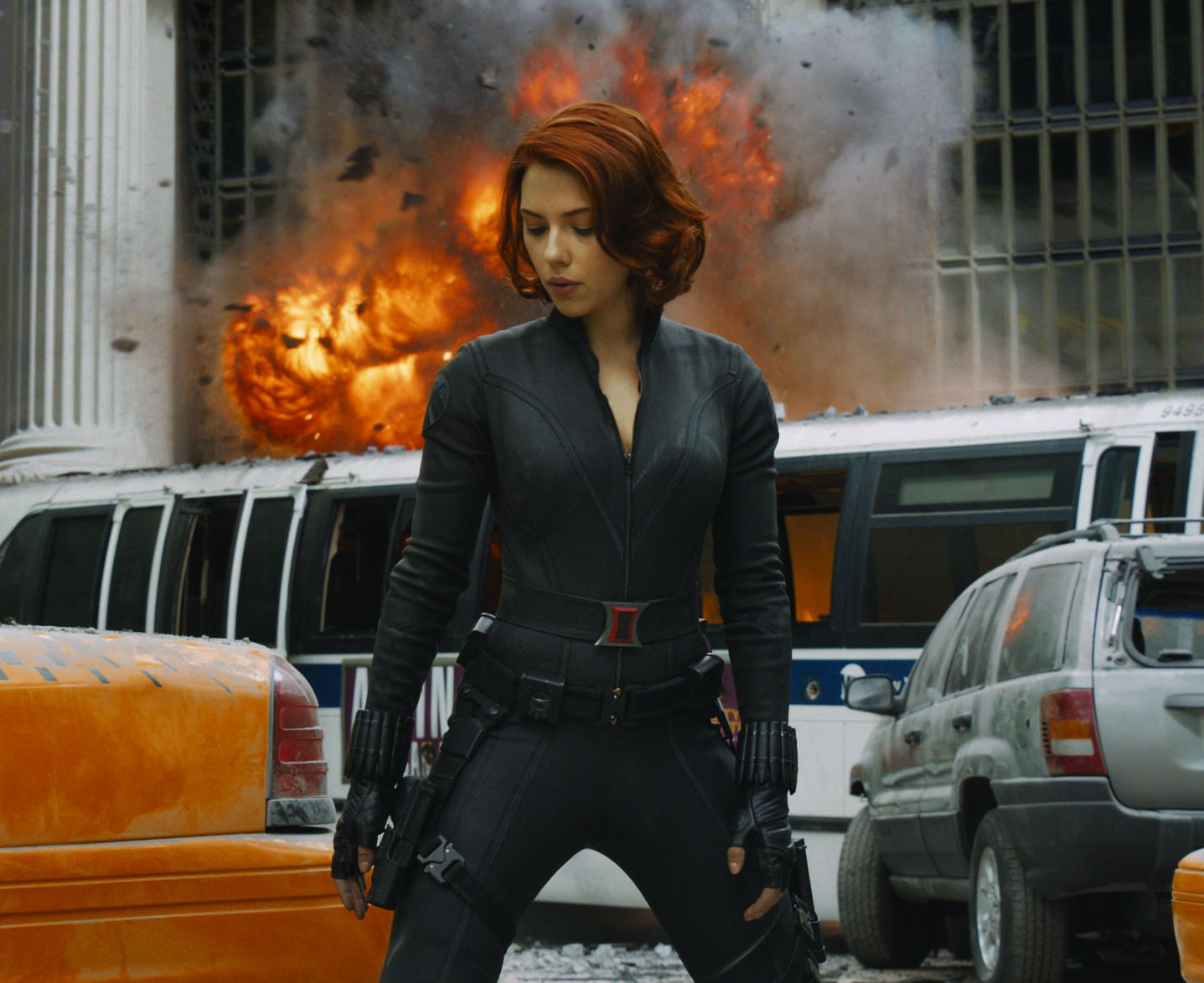 Scarlett Johansson as Black Widow and big fire on the street