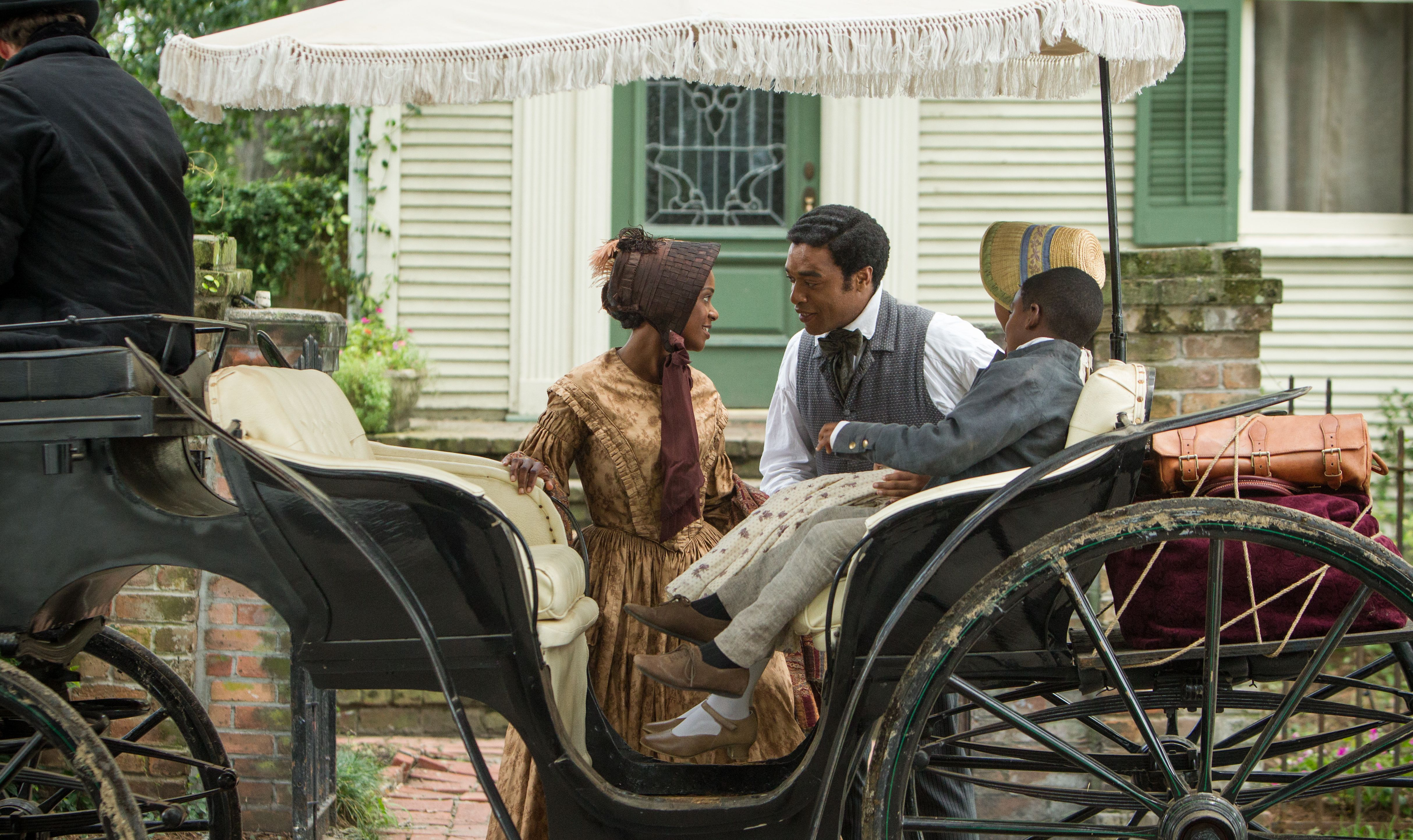 Chiwetel Ejiofor as a free Solomon Northup with his children
