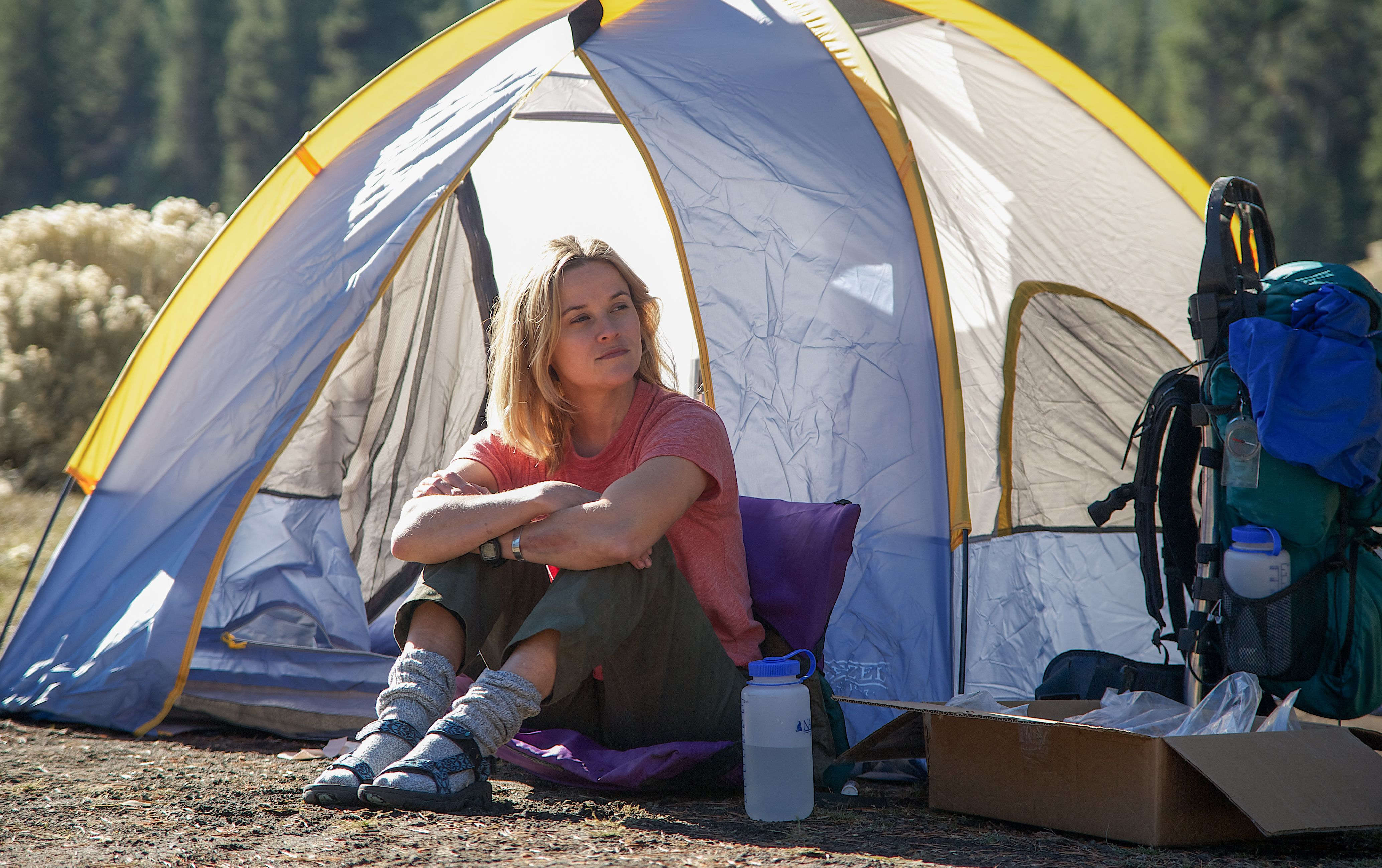 Reese Witherspoon in front of her tent, retro sandals and so