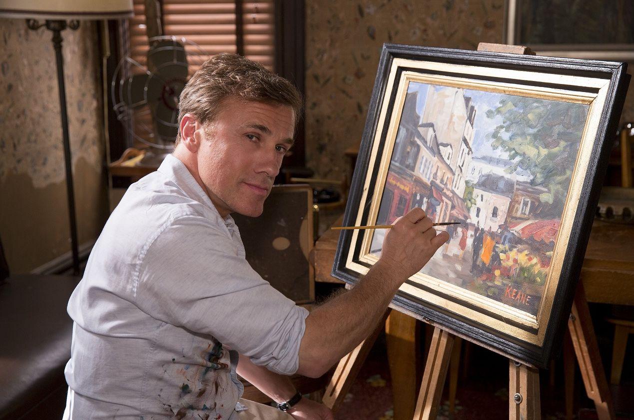Keane (Christoph Waltz) paints a landscape.
