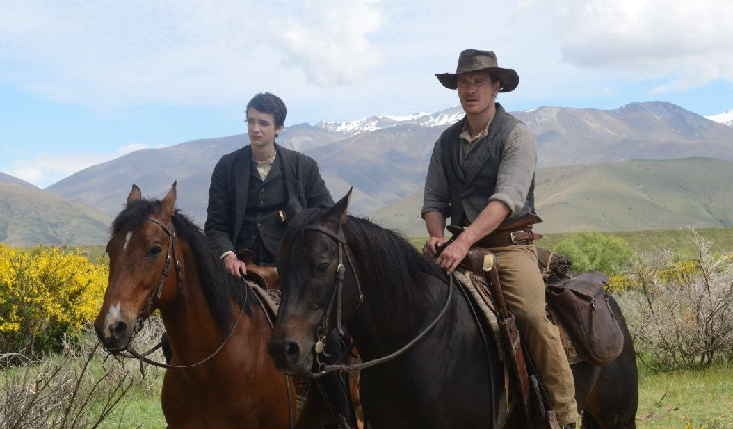 Michael Fassbender and Kodi Smit-McPhee ride their horses in