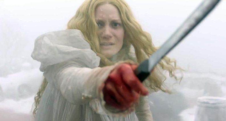 Mia Wasikowska scared and bloody in Crimson Peak
