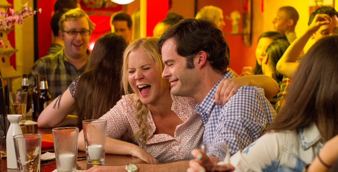 Amy Schumer and Bill Hader at a bar