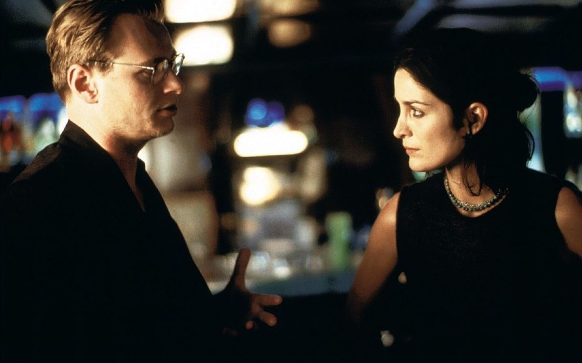 Director Christopher Nolan with Carrie-Anne Moss