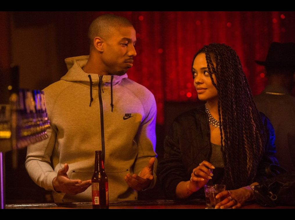 Adonnis Creed and his girlfriend sharing a drink at the club