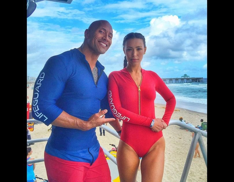 Dwayne Johnson as Mitch Buchannon & Ilfenesh Hadera as Steph