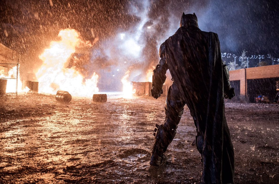 Behind the scenes image shows Batman facing down the fire in