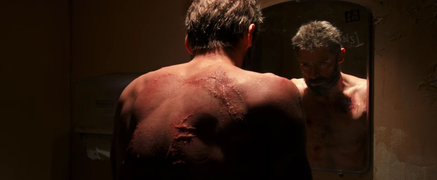 Logan with scars