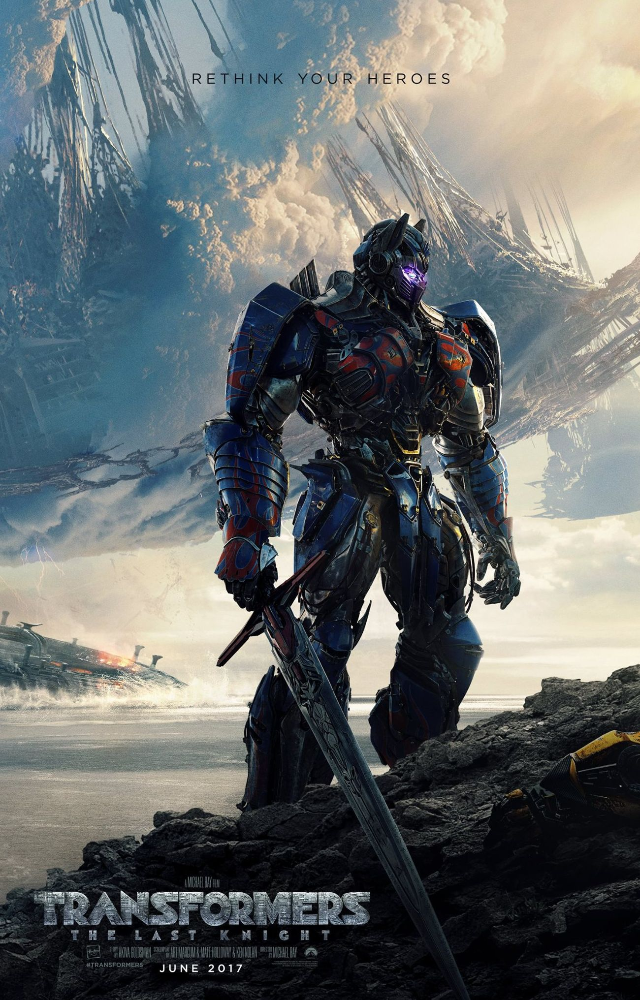Optimus Prime stands over a fallen hero in the new poster fo