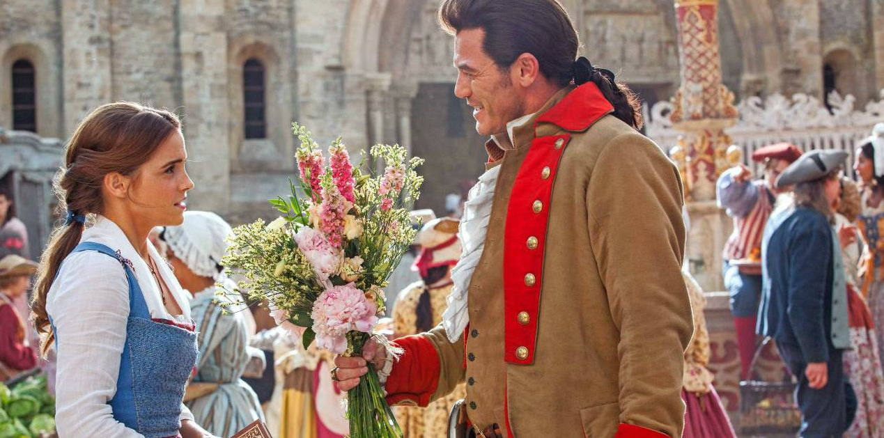 "Emma Watson (""Belle"") and Luke Evans (""Gaston"") in ""Beauty and the Beast."""