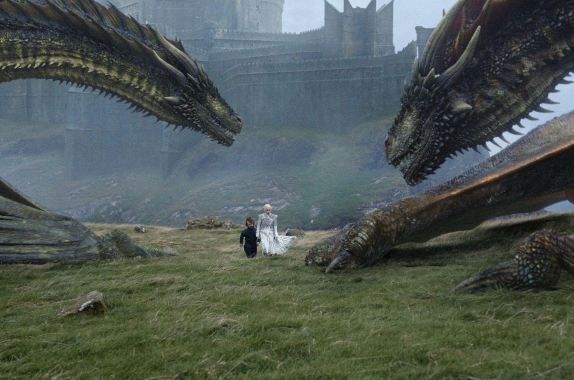 Danny and Tyrion among her dragons