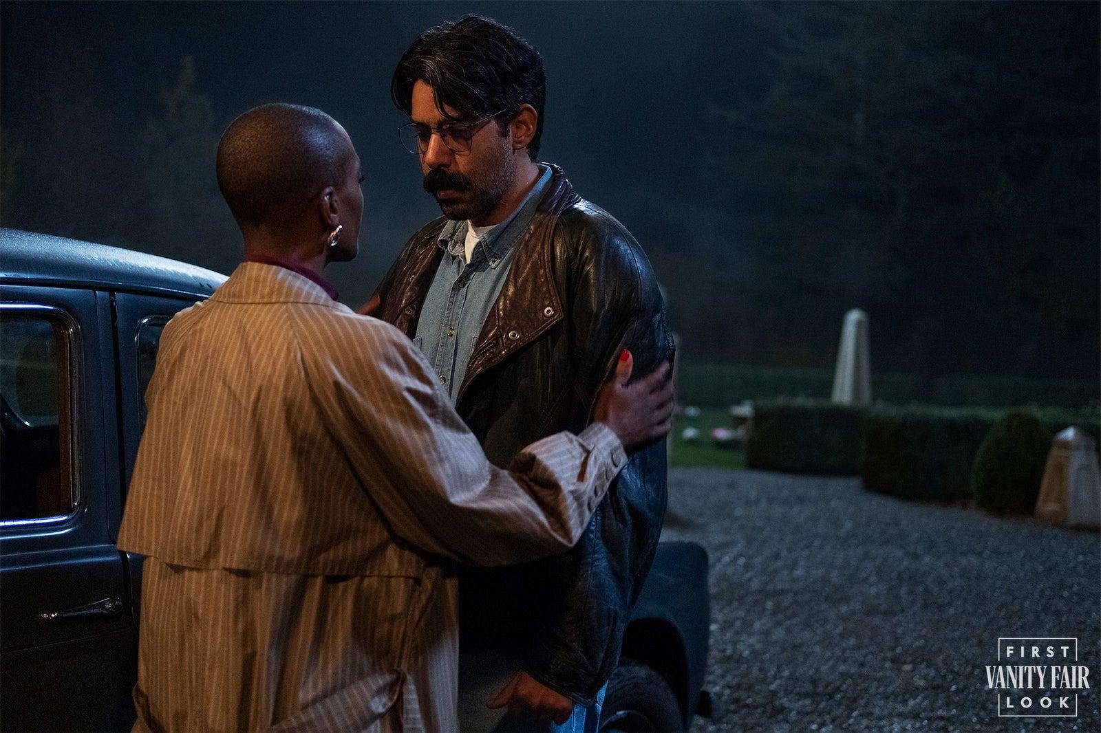 Mrs. Grose comforts Rahul Kohli's chef Owen on the grounds outside Bly Manor. EIKE SCHROTER/NETFLIX