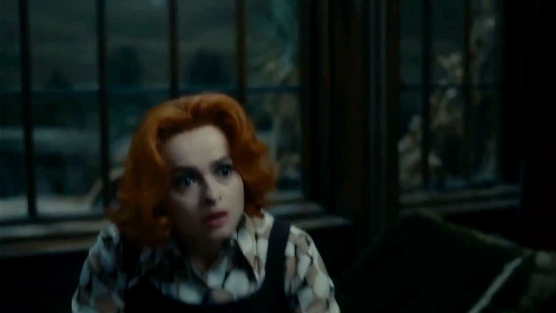 Michelle Pfeiffer and Helena Bonham Carter argue about the vampire in the house. Dark Shadows