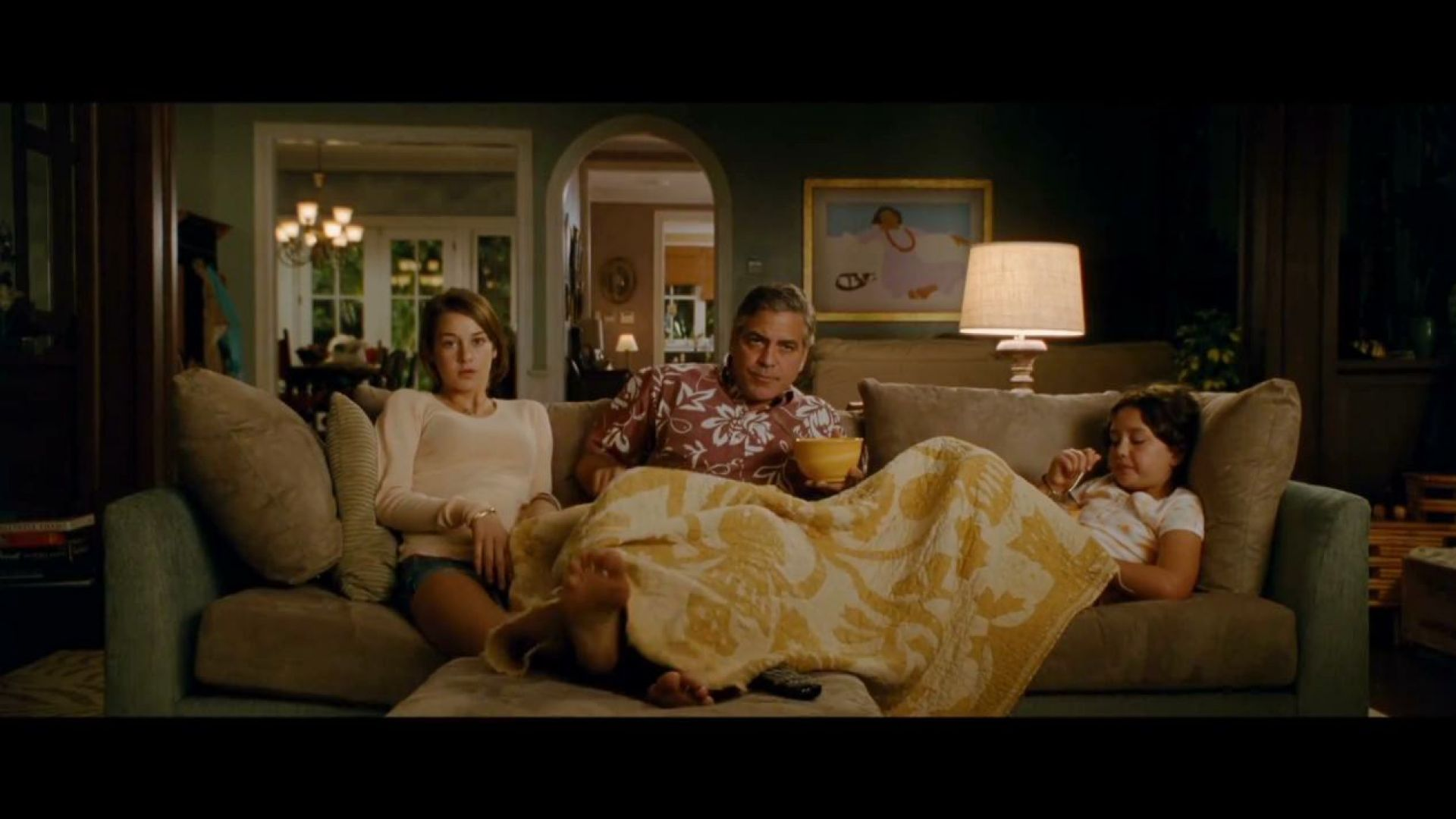 George Clooney and his daughters watch March of the Penguins in The Descendants