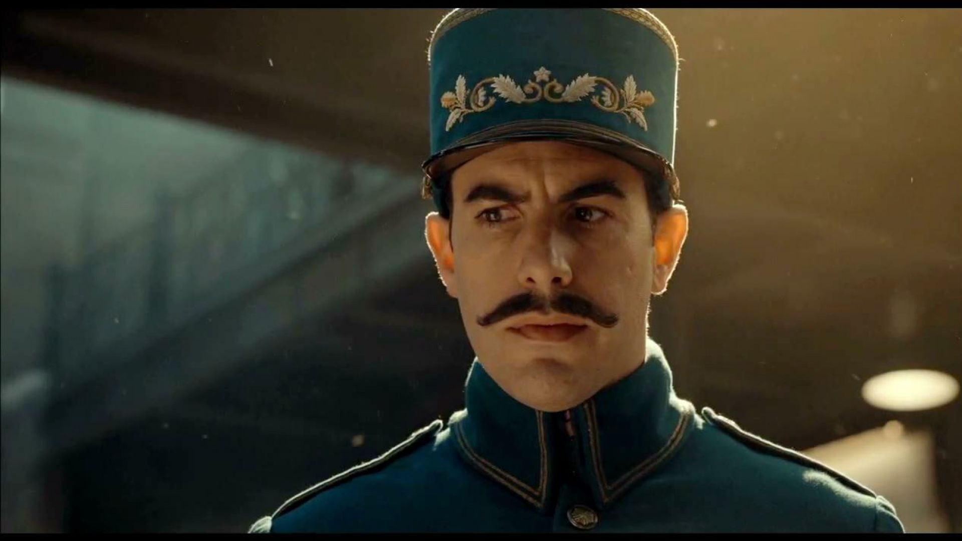 Sacha Baron Cohen as the station inspector in Hugo