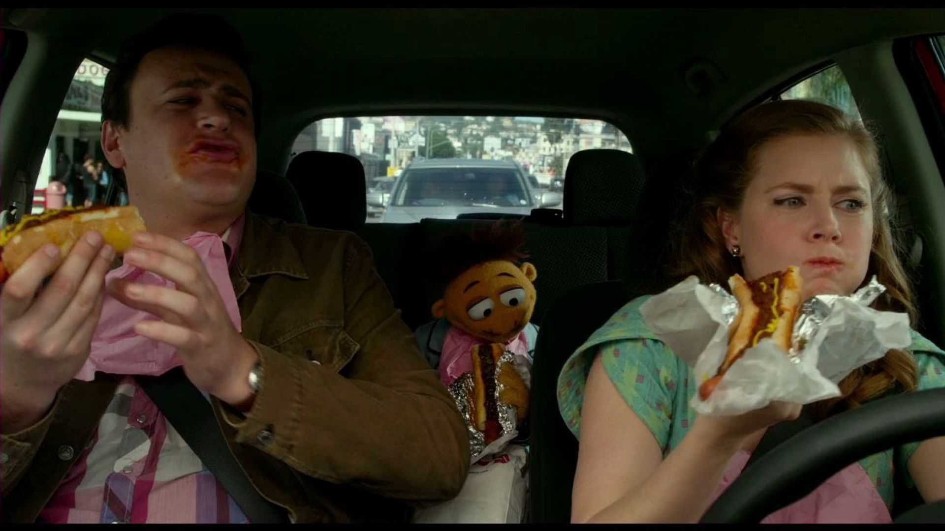 Walter, Jason Segel and Amy Adams stop to get hot dogs in The Muppets