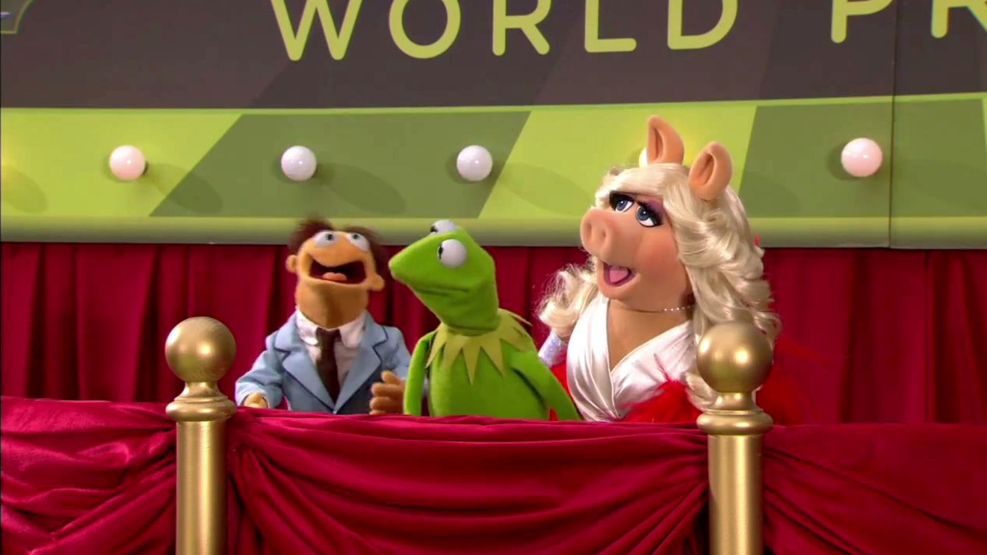Kermit, Miss Piggy and Walter report from the green carpet at the world premiere of The Muppets