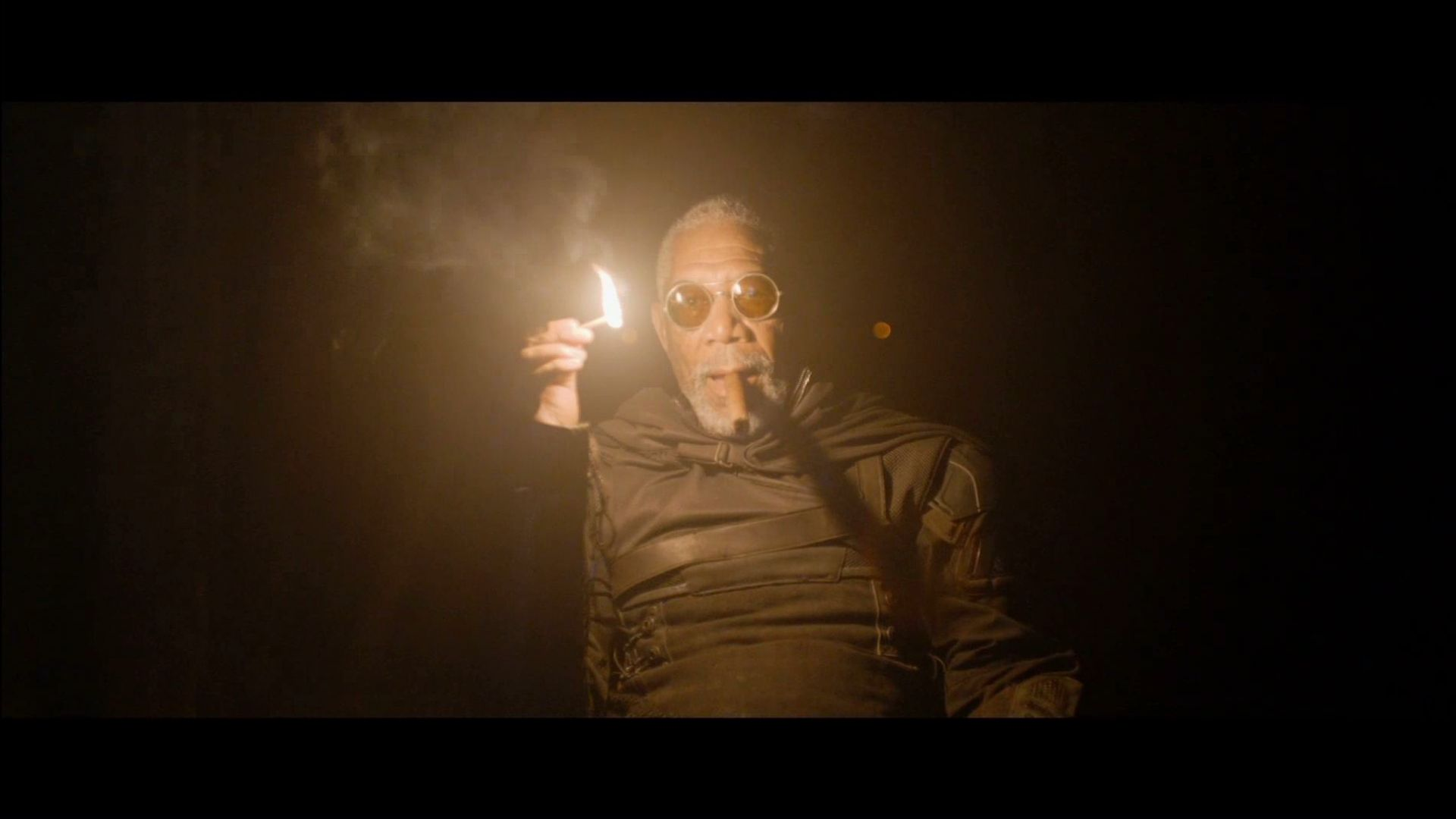 Morgan Freeman lights a match and interrogates Tom Cruise in Oblivion