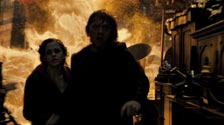 Harry, Hermione and Ron run from the fire in the Room of Requirement